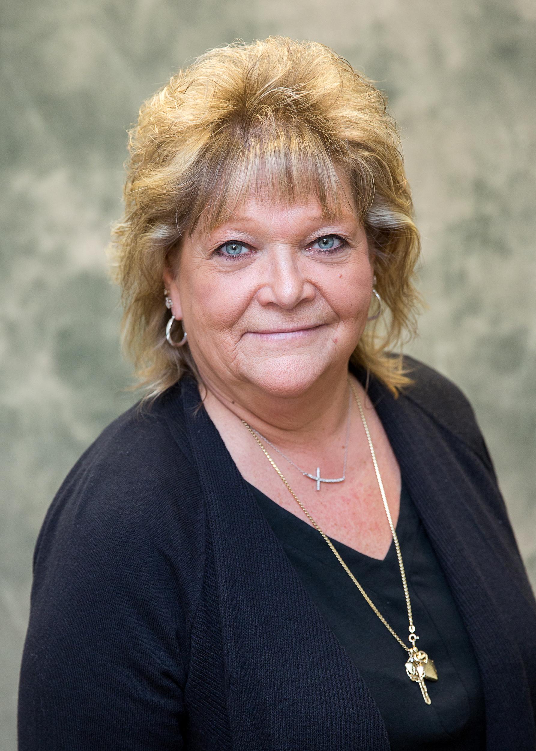 Mary Mannino, Receptionist